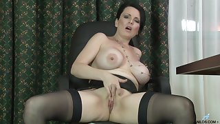 Well-endowed mature cookie Stacy Ray enjoys masturbating while diggings simply