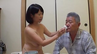 Japan grown up stands nude and pleases her man the right similar to one another